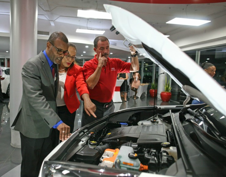 Minister in the Ministry of Transport, Peter Phillips examining the vehicle with MQI representatives.