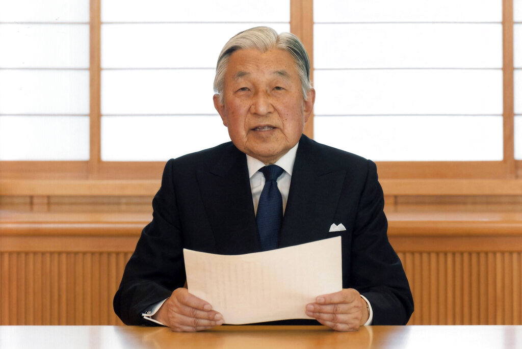 In this Aug. 7, 2016, file photo, provided by the Imperial Household Agency of Japan, Japan's Emperor Akihito reads a message for recording at the Imperial Palace in Tokyo.  (Imperial Household Agency of Japan via AP, File)