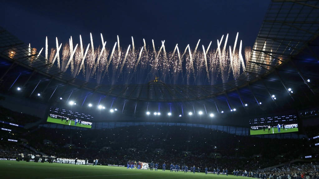 Fireworks explode above the stadium as the teams stand on the pitch before the start of the English Premier League football match between Tottenham Hotspur and Crystal Palace, the first Premiership match at the new Tottenham Hotspur stadium in London, Wednesday, April 3, 2019.
