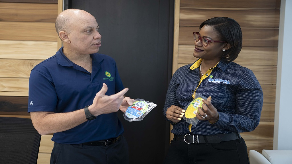 Jamaica Producers (JP) Group CEO Jeffery Hall discusses distribution plans for the new JP St Mary's Banana Bread with JP Tropical Foods Commercial Manager Tara Goulbourne.