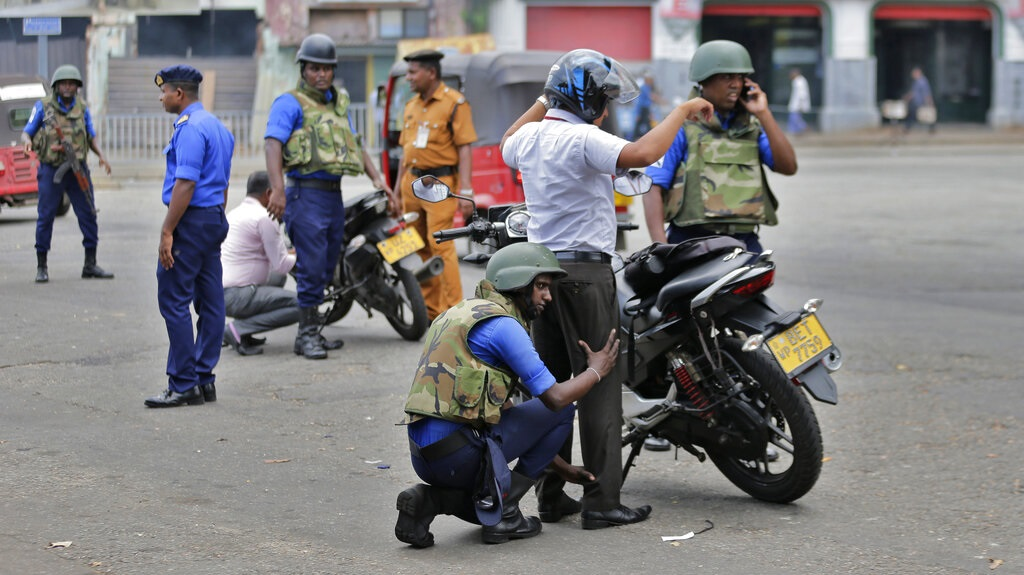 Sri Lankan navy soldiers perform security checks on motorists at a road in Colombo, Sri Lanka, Thursday, April 25, 2019. Sri Lanka banned drones and unmanned aircraft and set off more controlled detonations of suspicious items Thursday four days after suicide bombing attacks killed more than 350 people in and around the capital of Colombo. (AP Photo/Eranga Jayawardena)