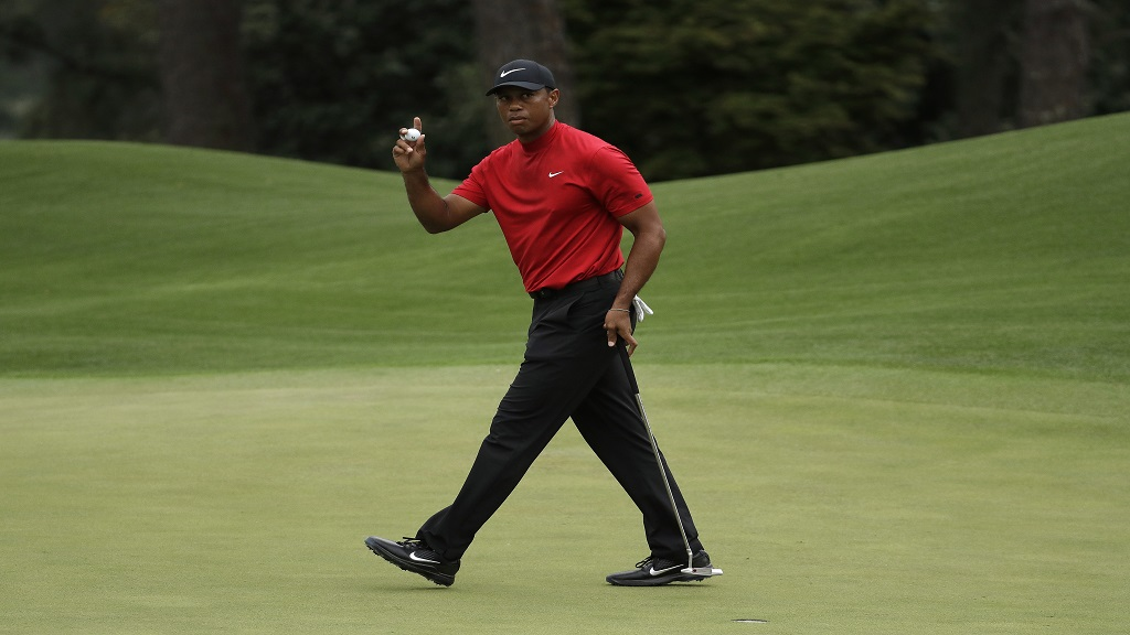 Tiger Woods waves on the eighth hole during the final round for the Masters golf tournament, Sunday, April 14, 2019, in Augusta, Ga. (AP Photo/Chris Carlson)