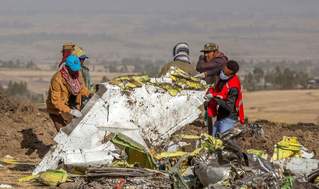 FILE - In this Monday, March 11, 2019 file photo, rescuers work at the scene of an Ethiopian Airlines flight crash near Bishoftu, or Debre Zeit, south of Addis Ababa, Ethiopia. (AP Photo/Mulugeta Ayene, File)