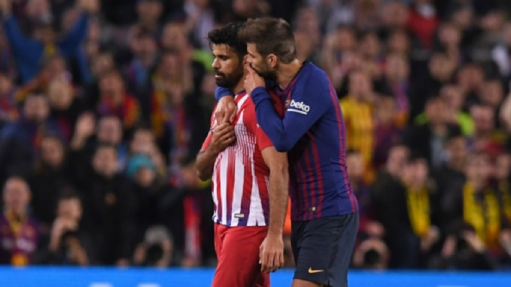 Atletico Madrid striker Diego Costa with Barcelona defender Gerard Pique.
