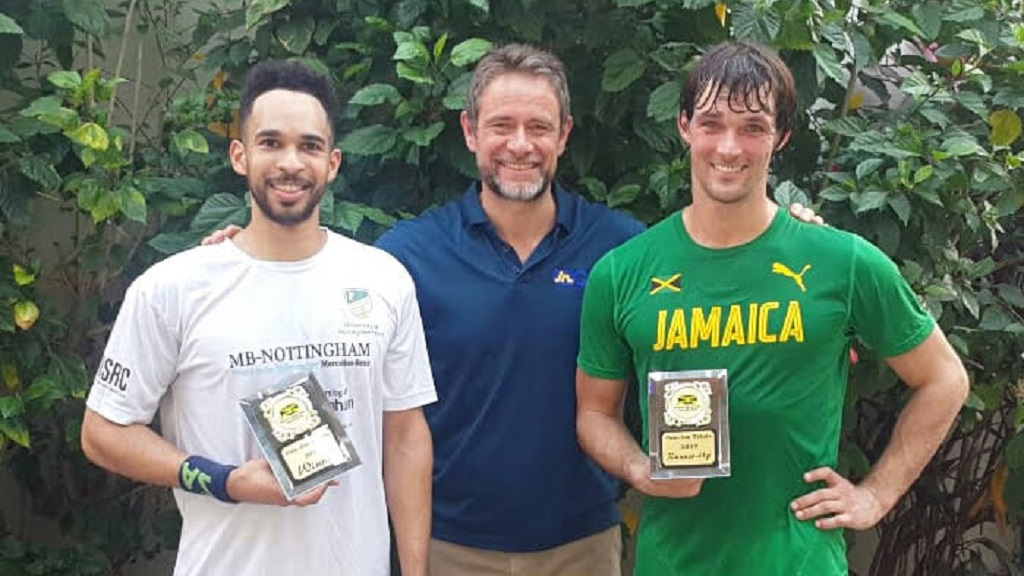 Chris Hind, (centre), president of the Jamaica Squash Association, joins players Lewis Walters (left) and Bruce Burrowes as they display their awards after qualifying to represent Jamaica at the 2019 Pan-American Games following the trials, which were contested from April 10-12 at the Liguanea Club in New Kingston.