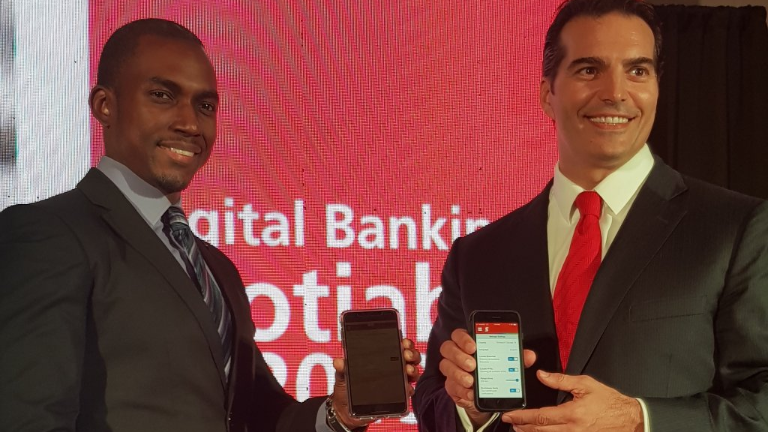 Scotiabank's Managing Director Stephen Bagnoral, right, with Damian Jones, General Manager, Corporate and Commercial Banking, Scotiabank at the launch of the bank's digital services on Thursday night.