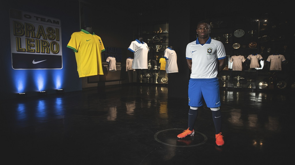 In this April 9, 2019 photo released by Nike, Brazil's football player Vinicius Junior models the new jersey that his national team will wear at this years' Copa America tournament in Rio de Janeiro, Brazil. The tournament will be played June 14 to July 7 in five Brazilian cities.