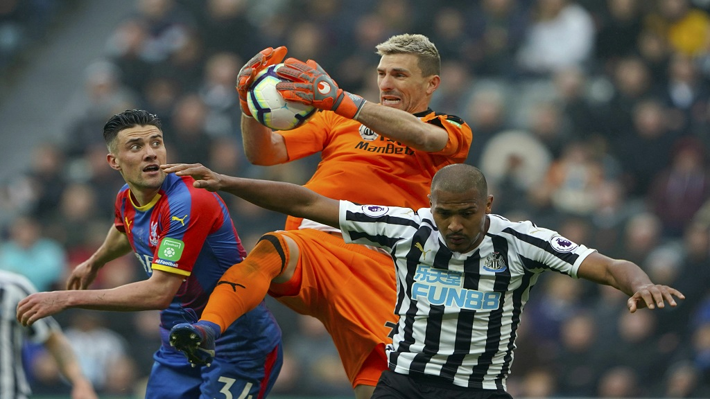 Crystal Palace goalkeeper Vicente Guaita makes a save during the English Premier League football match against Newcastle United at St James' Park, Newcastle, England, Saturday April 6, 2019.