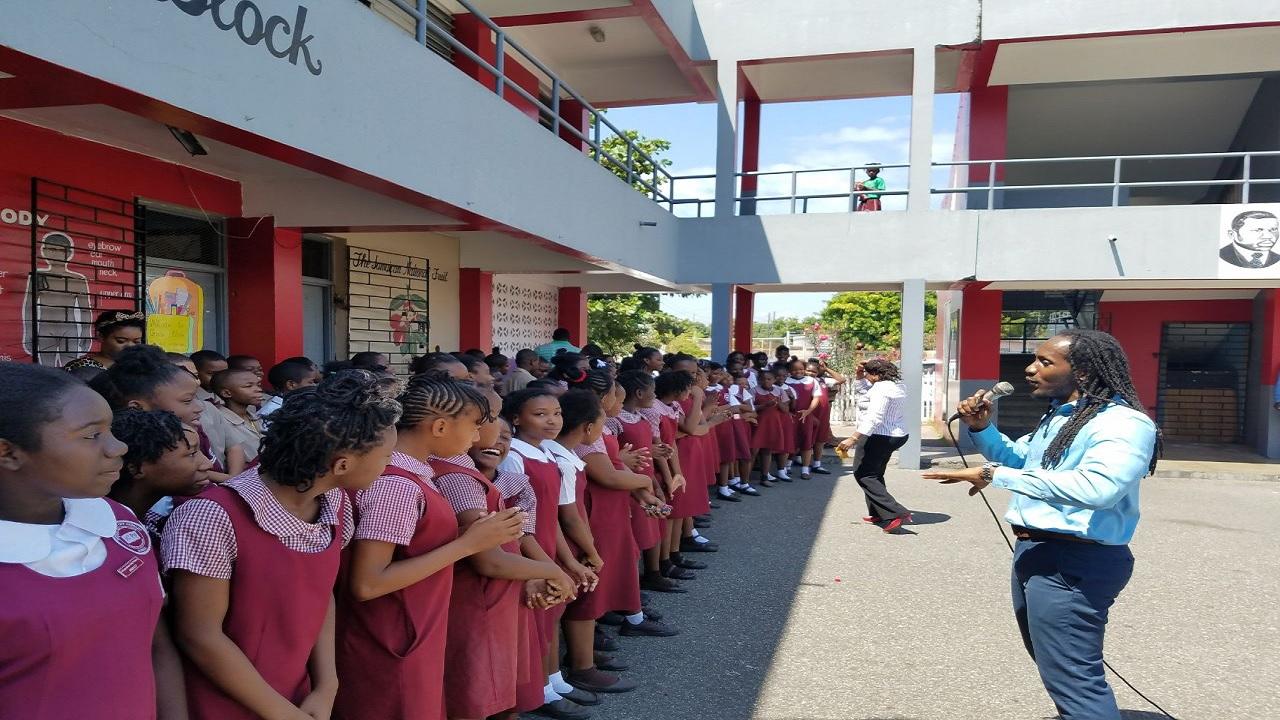 MP Alando Terrelonge talks to primary school children during his annual pre-GSAT devotion and motivation exercise on Thursday morning.