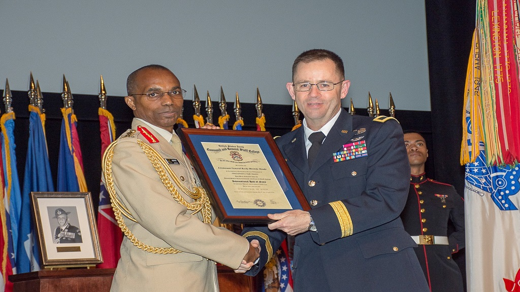 Lieutenant General Rocky Meade, Chief of the Defence Staff, Jamaica Defence Force receives his induction award from Brigadier General Troy Galloway, Deputy Commanding General, Army National Guard, US Army Combined Arms Center. (PHOTO: Contributed)