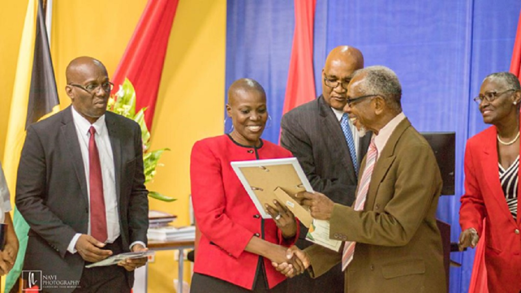 Sister Raia Richards-Peart collects a certificate of appreciation for the Arrington's (Humanitarians serving a mission in Jamaica) on behalf of the Church of Jesus Christ of Latter-day Saints in Jamaica.