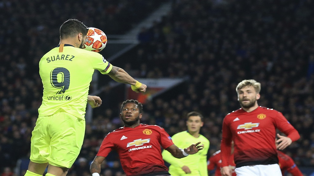 Barcelona's Luis Suarez heads toward goal during the Champions League quarterfinal, first leg, football match against Manchester United at Old Trafford stadium in Manchester, England, Wednesday, April 10, 2019. Suarez's header deflected off Luke Shaw and into the back of the net.