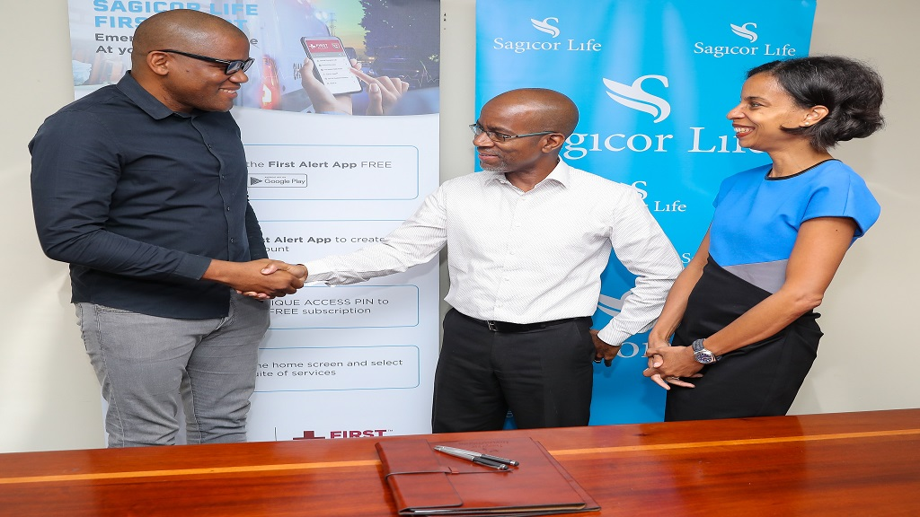 Executive Vice President of the Employee Benefits Division (EBD), Sagicor Life, Willard Brown (centre), greets Managing Partner, First Responder's Technology Limited, Aldain Reid, during a signing ceremony recently. Looking on is Vice President of EBD, Nicola Leo-Rhynie (right).