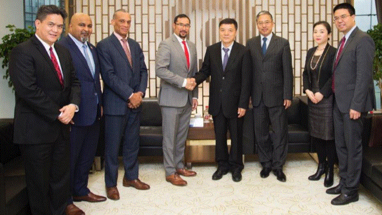 From left to right: NGC President Mark Loquan, Ambassador to China Stephen B. Seedansingh Jr., Minister of Foreign Affairs, Trinidad and Tobago Dennis Moses, Minister in the Office of the Prime Minister Stuart Young, Ju Weimin, Vice Chairman and President, China Investment Corporation (CIC); Mr Benjamin Bao, Managing Director, CIC Capital Corporation; Ms Lu Yuling, Beijing Rheingau Investment Corporation; Mr Xu Zhiyu, Director, Department of Public Relations & International Cooperation, CIC.