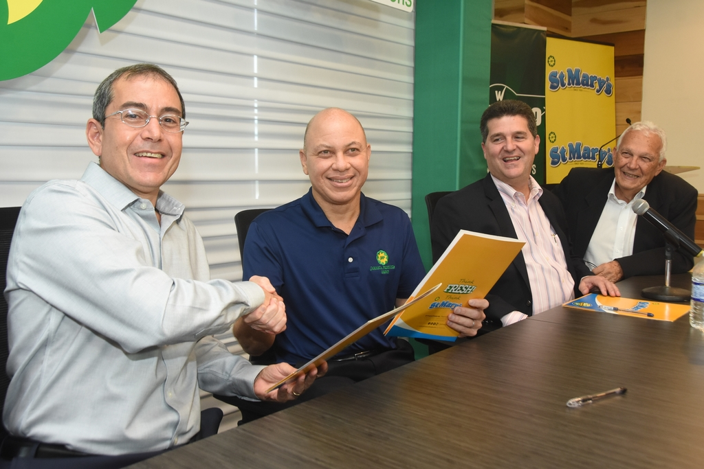 Wisynco Group CEO Andrew Mahfood (left) and JP Group CEO Jeffery Hall (second left) seal the joint-venture deal with a handshake. Also pictured is Wisynco chairman William Mahfood (second right) and JP chairman Charles Johnston (right).