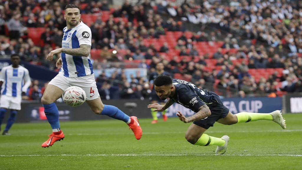 Manchester City's Gabriel Jesus scores the opening goal during the English FA Cup semifinal football match against  Brighton & Hove Albion at Wembley Stadium in London, Saturday, April 6, 2019.