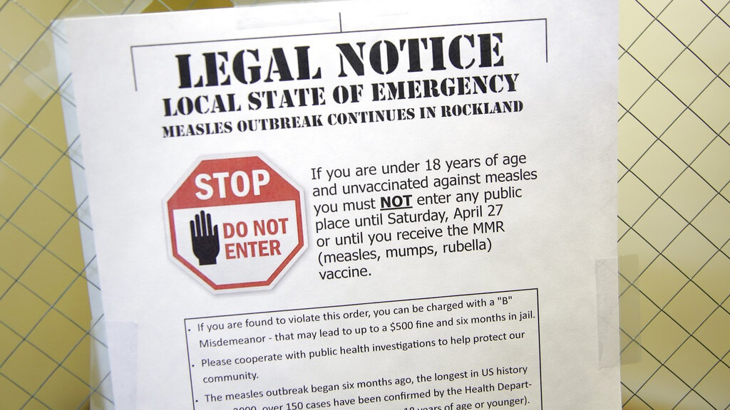 This Wednesday, March 27, 2019 file photo shows a sign explaining the local state of emergency because of a measles outbreak at the Rockland County Health Department in Pomona, N.Y.  (AP Photo/Seth Wenig)