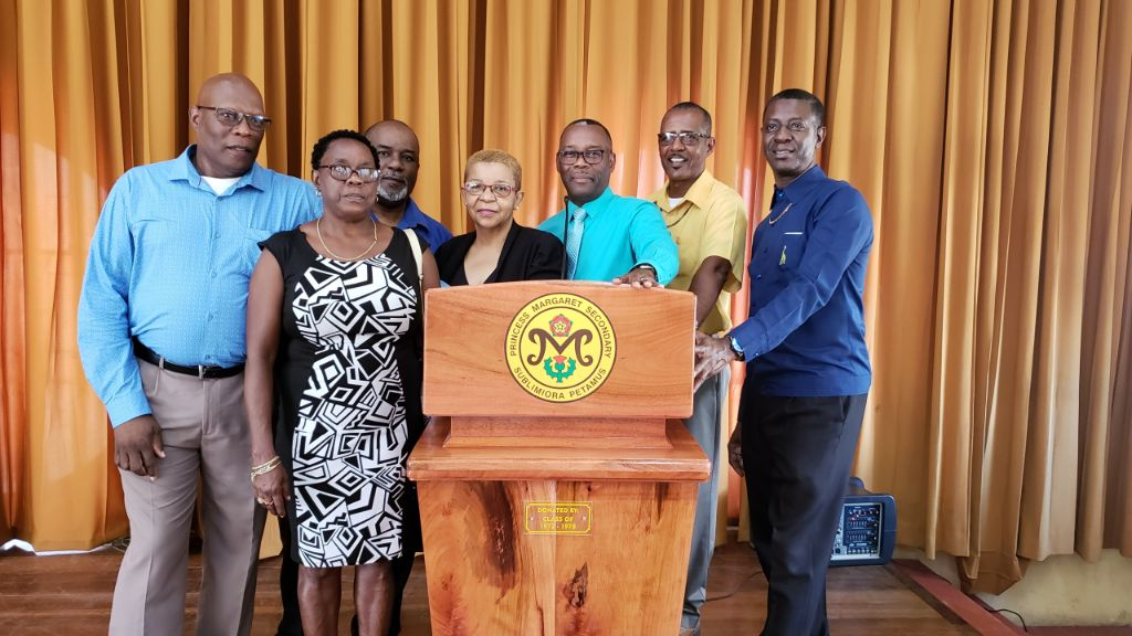 Class of 1972-78 donate new podium with state-of-the-art podium microphone to their old school Princess Margaret Secondary School.