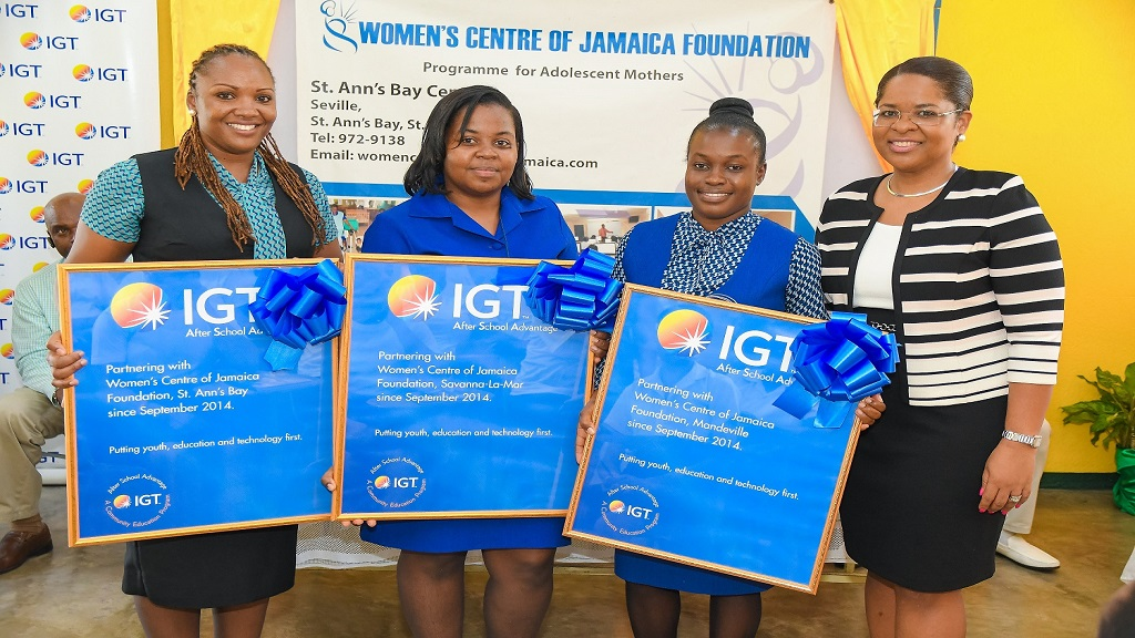 Representatives from the Women's Centre of Jamaica Foundation (WCJF) proudly display their new IGT After School Advantage centre plaques at a special Women's Month session held at the St Ann's Bay centre.