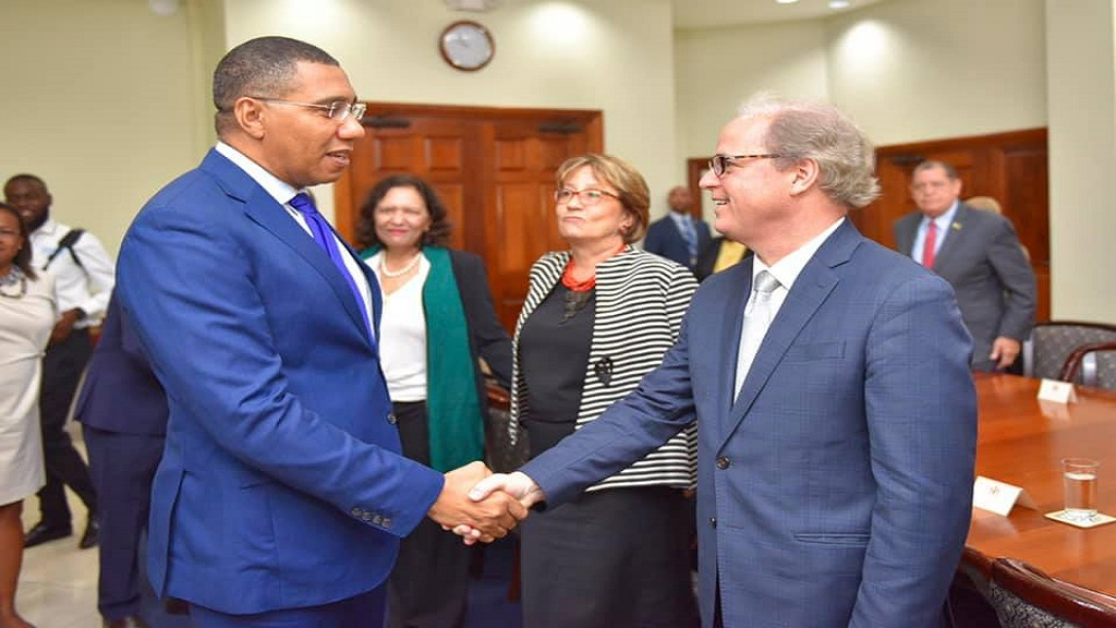 Prime Minister Andrew Holness greets World Bank Vice President for Latin America and the Caribbean Axel van Trotsenburg.