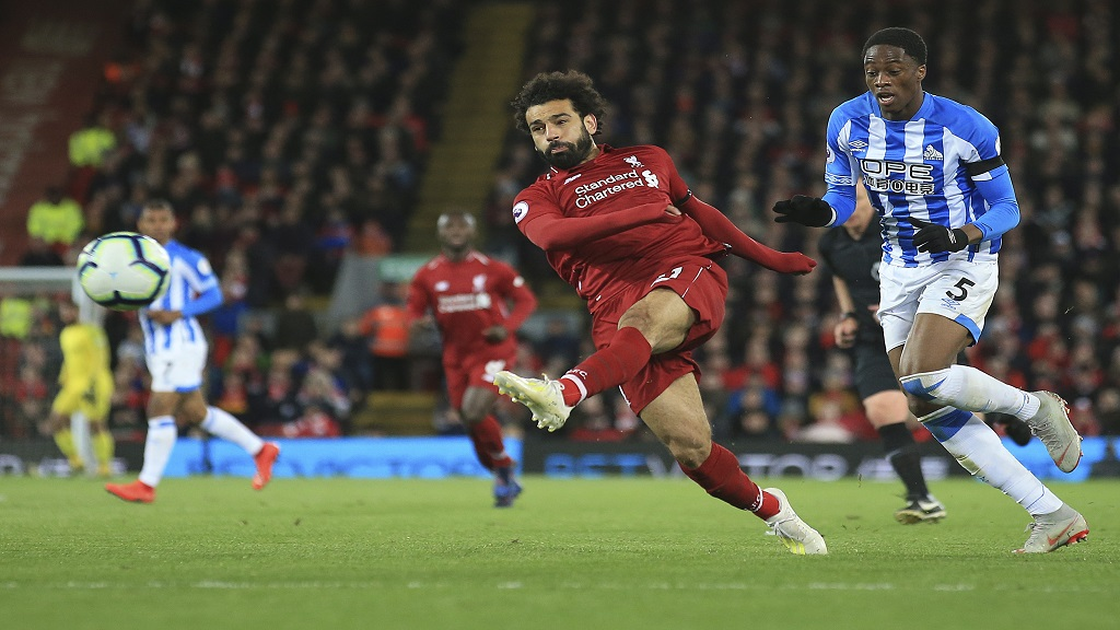 Liverpool's Mohamed Salah shoots on goal during the English Premier League football match against Huddersfield Town at Anfield Stadium, in Liverpool, England, Friday, April 26, 2019.