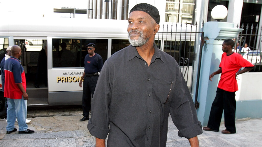 In this Aug. 6, 2007, file photo, Guyanese Abdul Kadir, former member of the South American nation's Parliament, arrives at the Magistrates' Court for an extradition hearing in downtown Port-of-Spain, Trinidad. (AP Photo/Andres Leighton)