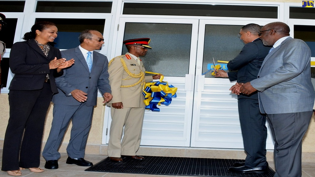 Prime Minister Andrew Holness (second right) cuts the ribbon to officially open the Lathbury Barracks at Up Park Camp, St Andrew on April 26. Sharing in the occasion (from left) are Attorney General, Marlene Malahoo Forte; National Security Minister, Dr. Horace Chang; Chief of Defence Staff, Lieutenant General, Rocky Meade; and Opposition Spokesperson on National Security, Fitz Jackson.