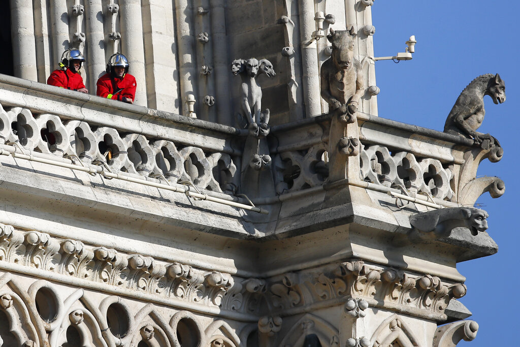 Fire fighters wait at a balcony of Notre Dame cathedral Wednesday, April 17, 2019 in Paris. (AP Photo/Francois Mori)