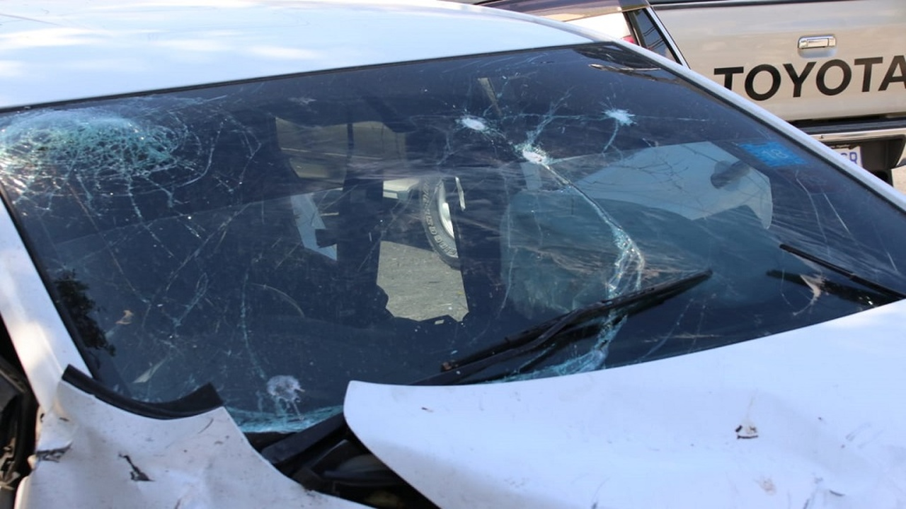 The crashed and shot-up car in which a group of 'rogue' cops was travelling with other men late on Saturday night when they reportedly shot and killed a man and were dramatically challenged by an off-duty policeman.