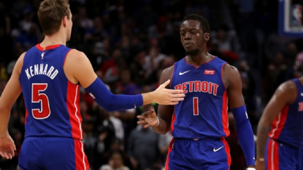 Luke Kennard and Reggie Jackson.