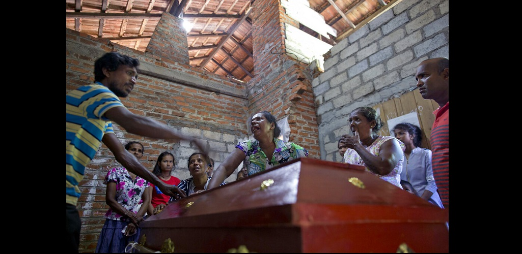 Relatives weep near the coffin with the remains of 12-year Sneha Savindi, who was a victim of Easter Sunday bombing at St. Sebastian Church, after it returned home, Monday, April 22, 2019 in Negombo, Sri Lanka.