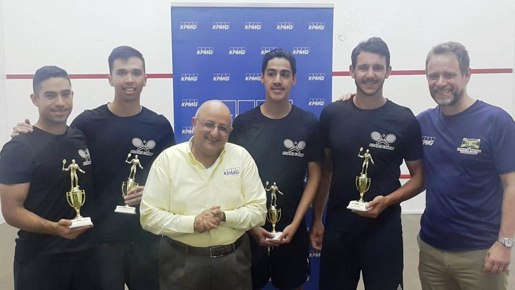 Tarun Handa, (second left) Managing Partner for KPMG in Jamaica, applauds as members of the Adams Family; (from left) Robert Roper, Adam Hugh, Adam Lee and Allan Roper display their trophies after winning the 2019 KPMG Squash League at the Liguanea Club at the weekend. The first time entrants beat the Power Bolts 3-0 to win the title.   Also on hand to congratulate the new champions is Chris Hind, President of the Jamaica Squash Association.