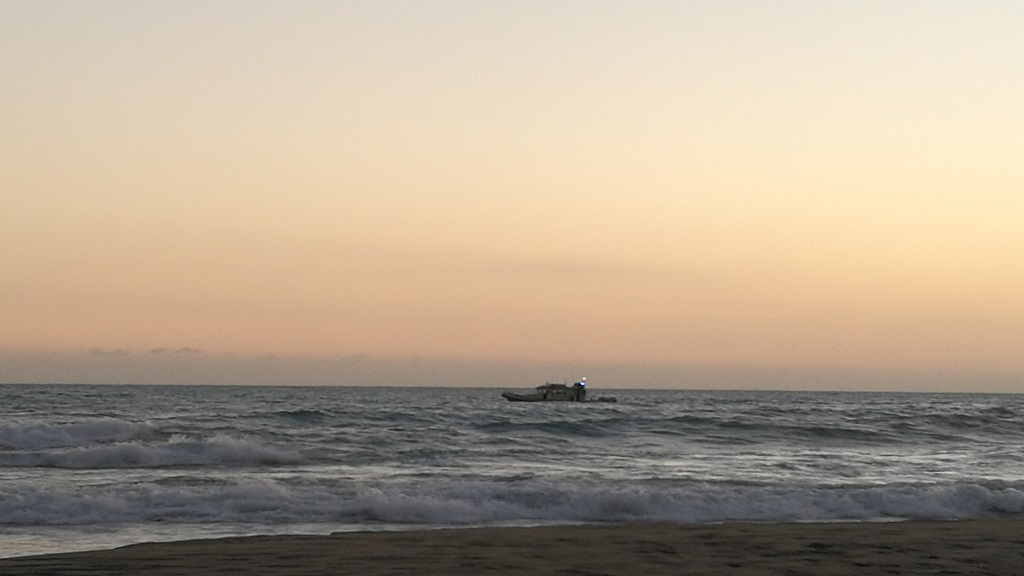 A Marine Police boat team searching for the missing and then presumed drowned men off the Treasure Beach coastline on Monday.