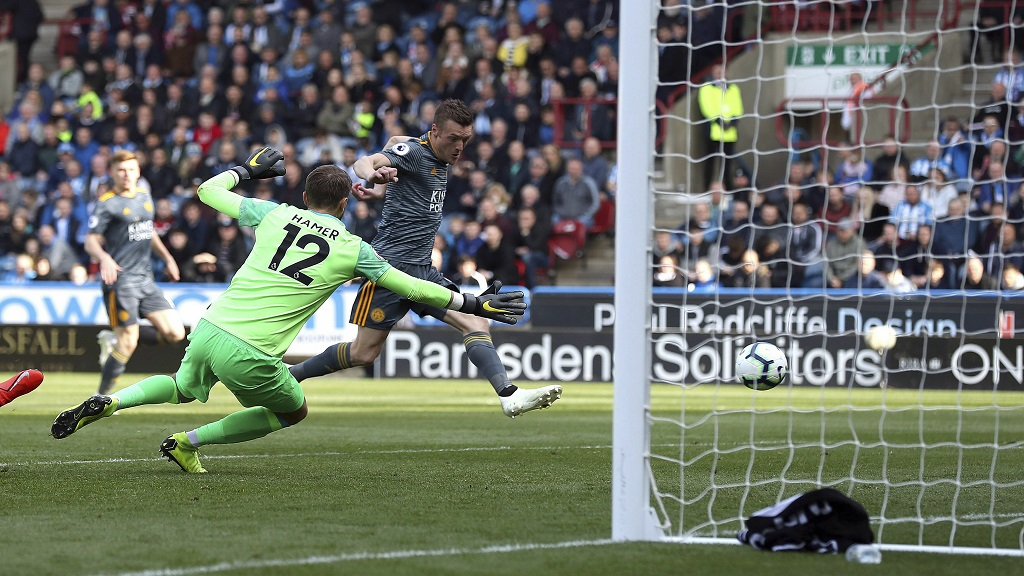 Leicester City's Jamie Vardy, right, scores against Huddersfield Town during the English Premier League football match at the John Smith's Stadium, Huddersfield, England, Saturday April 6, 2019.
