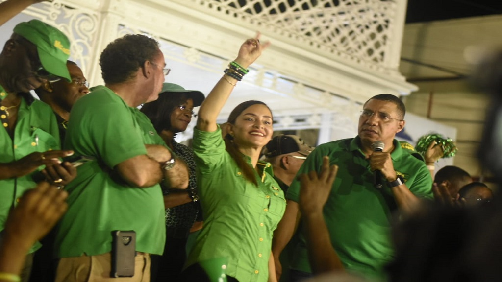 MP Elect for East Portland, Ann-Marie Vaz basks in her by-election victory on Thursday night alongside Prime Minister Andrew Holness (right), West Portland MP Daryl Vaz and other senior Labourites. (PHOTO: Marlon Reid)