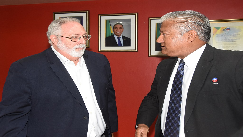 Jamaica Civil Aviation Authority (JCAA) Chairman, Phillip Henriques (left) and Director General, Nari Williams-Singh, in discussion at a press conference the authority recently hosted at its St Andrew office. (Photo: Marlon Reid)