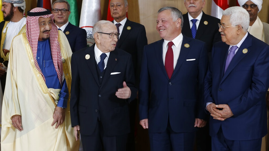 Tunisian President Beji Caid Essebsi, center left, stands with Saudi Arabia's King Salman bin Abdulaziz, left, Jordan's King Abdullah II, center right, and Palestinian President Mahmoud Abbas during the group photo with Arab leaders, ahead of the 30th Arab Summit in Tunis, Tunisia, Sunday, March 31, 2019.  (Zoubeir Souissi, Pool photo via AP)