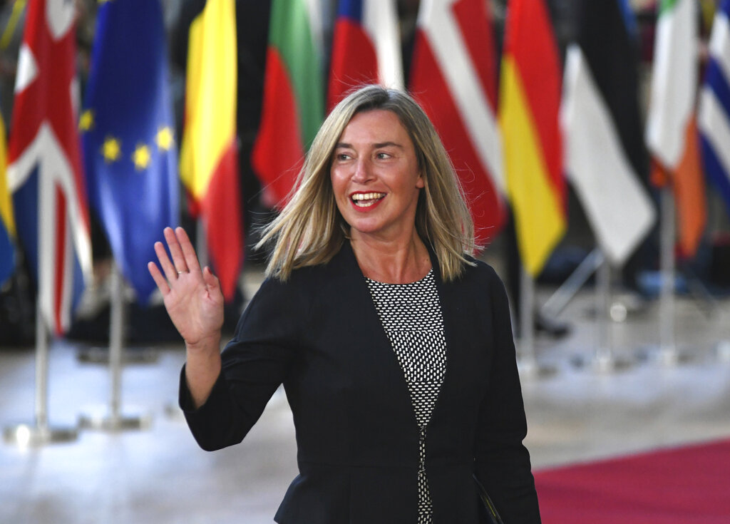 European Union foreign policy chief Federica Mogherini waves as she arrives for an EU summit at the Europa building in Brussels, Wednesday, April 10, 2019. (AP Photo/Riccardo Pareggiani)