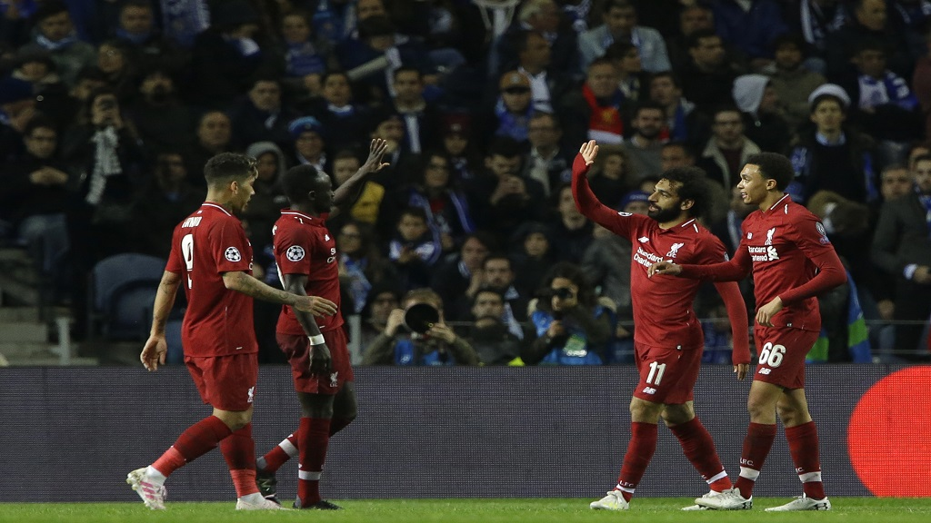Liverpool's Mohamed Salah, second right, celebrates after scoring his side's second goal during the Champions League quarterfinal, 2nd leg, football match against FC Porto at the Dragao stadium in Porto, Portugal, Wednesday, April 17, 2019.