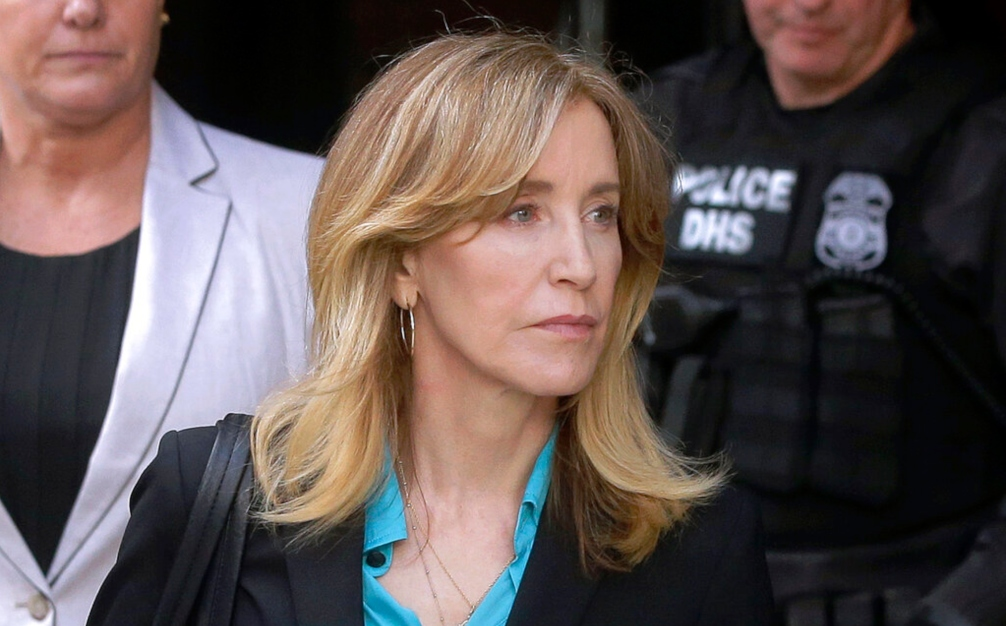 In this April 3, 2019 file photo, actress Felicity Huffman arrives at federal court in Boston to face charges in a nationwide college admissions bribery scandal. (AP Photo/Steven Senne, File)