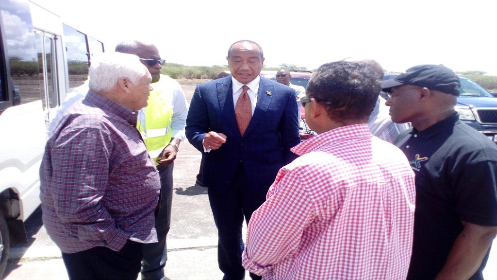 International business mogul and Chairman of Jamaica's Economic Growth Council, Michael Lee-Chin (centre), makes a point during a tour and fact-finding visit to the Vernamfield development in Clarendon last week. Also pictured (l-r) are    Minister Mike Henry of the OPM; Project Director, Lt Colonel Oscar Derby; Member of Parliament for South West Clarendon, Noel Arscott; Minister Audley Shaw (partly hidden), and Senator Aubyn Hill, Deputy Chairman of the growth council. (Photos: Reginald Allen)