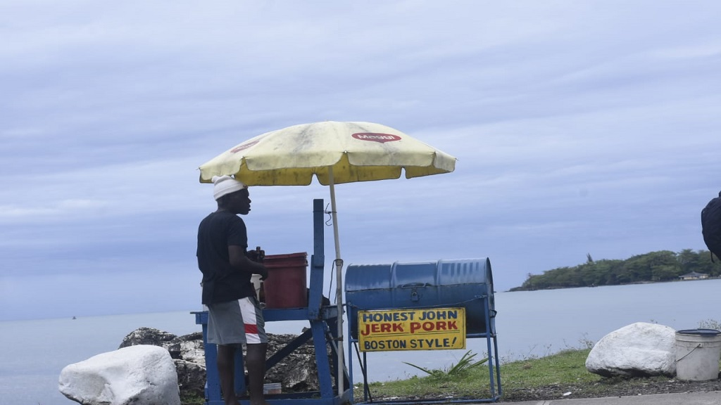 A pork vendor in Port Antonio, Portland on Thursday during by-election activities. (PHOTO: Marlon Reid)
