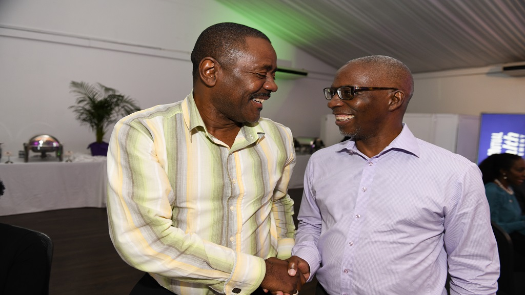 Businessman Harry Smith (left) shares a light moment with Peter Reid, Head of Building Society Operations at the Victoria Mutual Group, at the VM Wealth Post-budget Forum held at the Spanish Court hotel, New Kingston on Tuesday, March 19, 2019. The event featured experts in the field of economics and taxation discussing the potential impact of the 2019 national budget.
