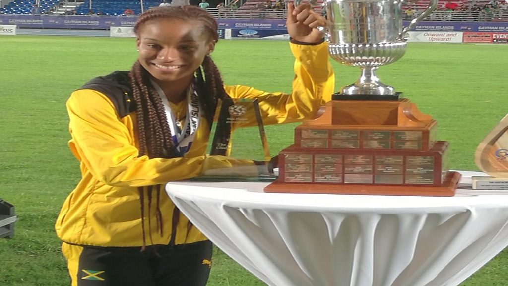Briana Williams poses with the Austin Sealy award on the final day of the Carifta Games in the Cayman Islands on Monday, April 22, 2019. Williams won the prestigious award for the second straight year.