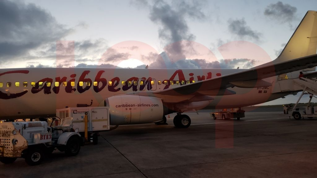 Early morning 6:00 am Caribbean Airlines flight at gate 12 at Grantley Adams International Airport.