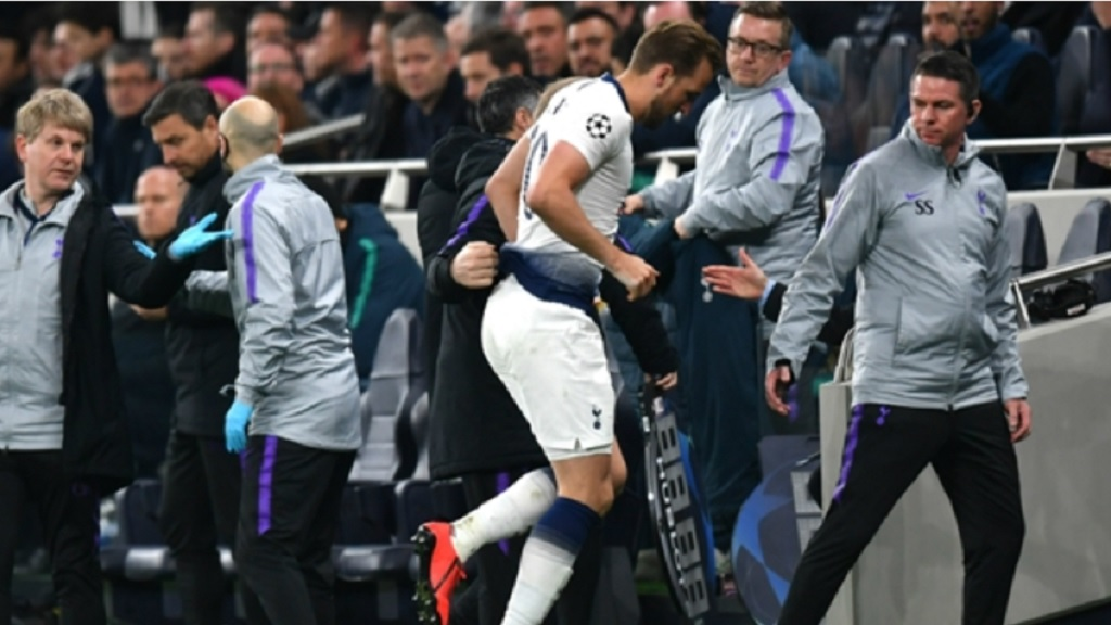 Harry Kane goes off injured for Tottenham.