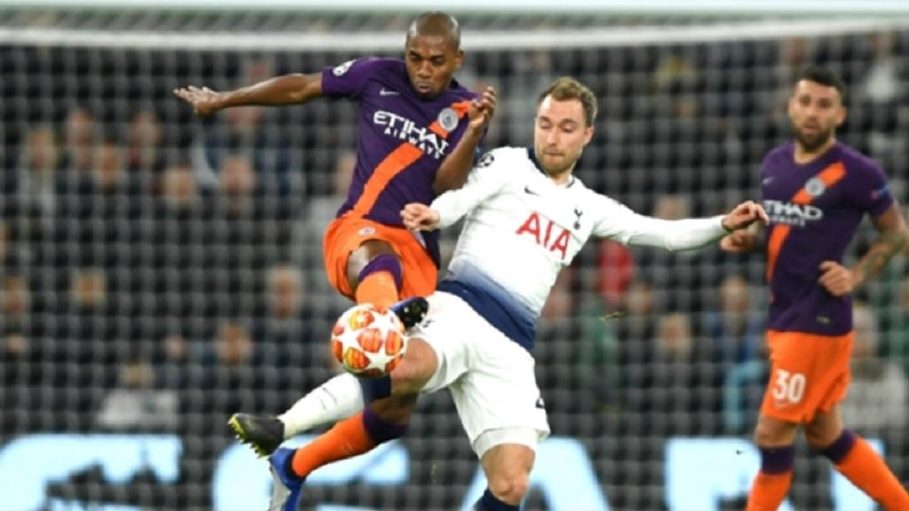 Manchester City midfielder Fernandinho challenges Christian Eriksen of Tottenham.