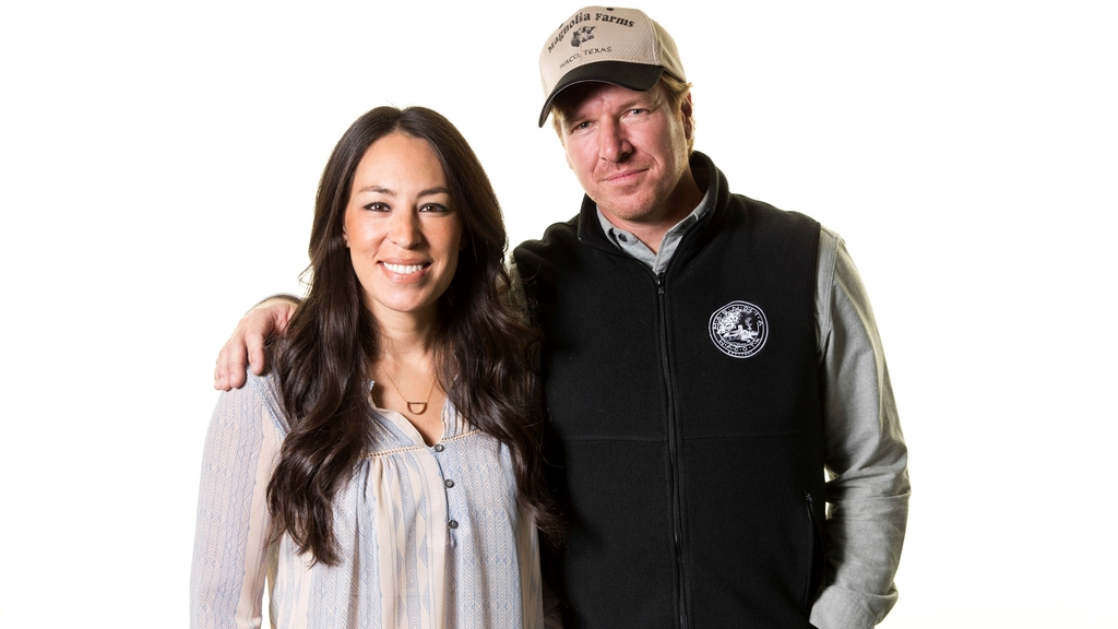 In this March 29, 2016, file photo, Joanna and Chip Gaines pose for a portrait in New York. The lifestyle team of Chip and Joanna Gaines will launch their own Discovery-affiliated television network in the summer of 2020. (Photo by Brian Ach/Invision/AP, File)