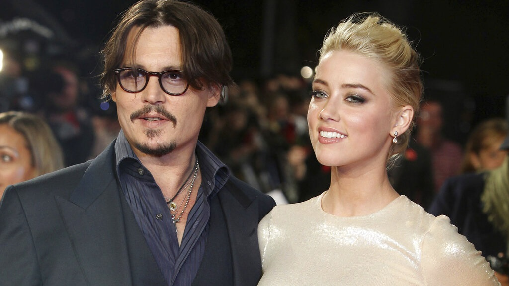 In this Nov. 3, 2011 file photo, U.S. actors Johnny Depp, left, and Amber Heard arrive for the European premiere of their film,