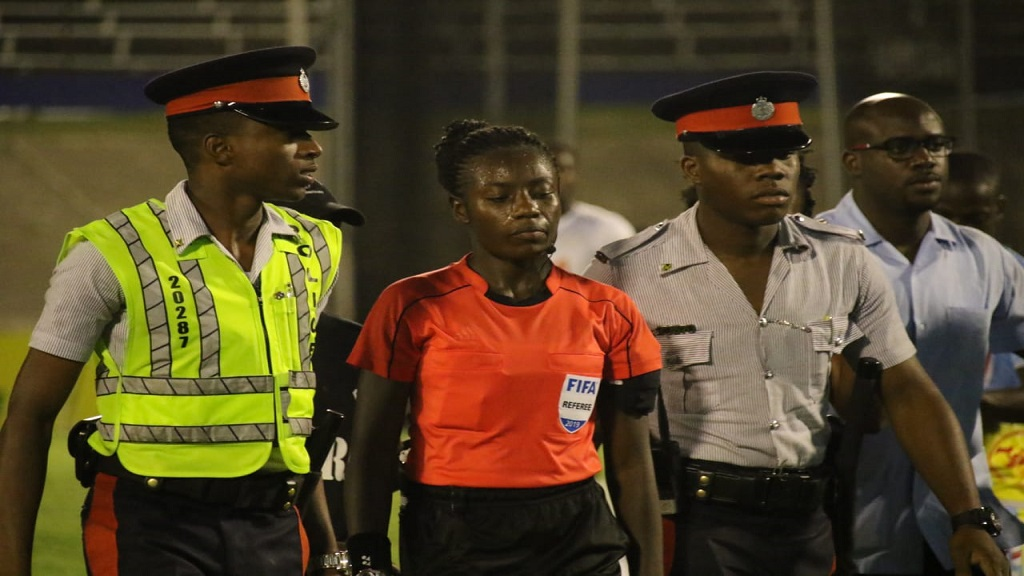 Police officers escort referee Odette Hamilton from the infield following the end of the RSPL final on Monday, April 29, 2019 at the National Stadium.